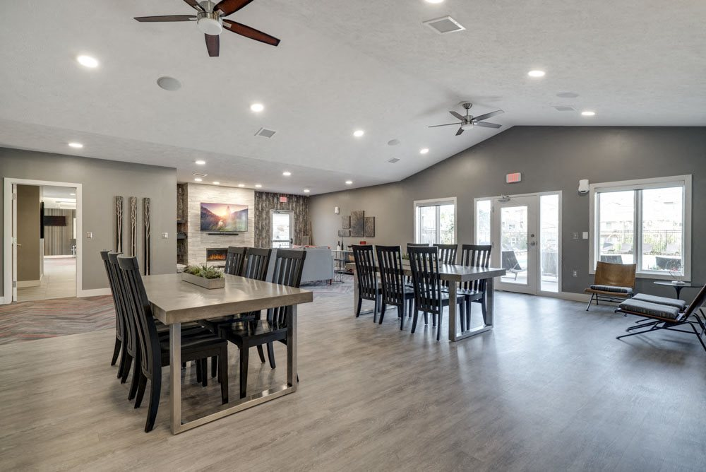 Clubhouse interior with tables and seating at Highland View Apartments in north Lincoln NE 68521