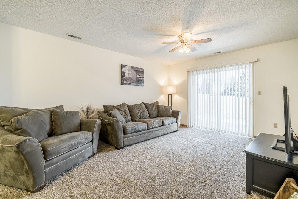 Interiors-Living room in 1-bedroom apartment with walkout patio