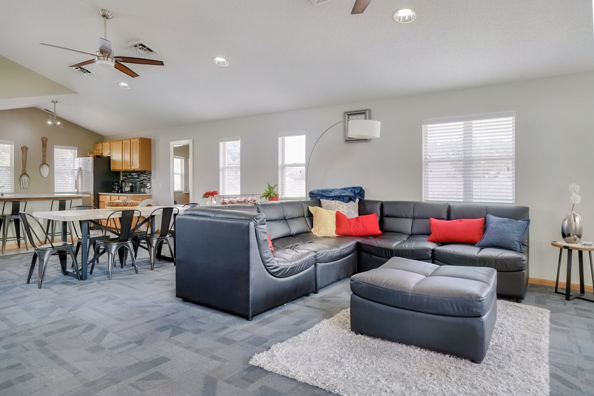 Common area with lounge area and kitchen in the clubhouse at Skyline View apartments
