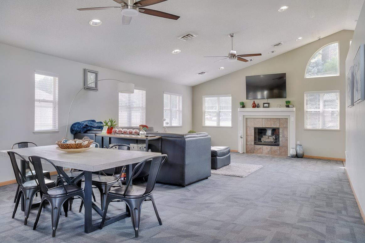 Common area with lounge area, fireplace and kitchen in the clubhouse at Skyline View apartments