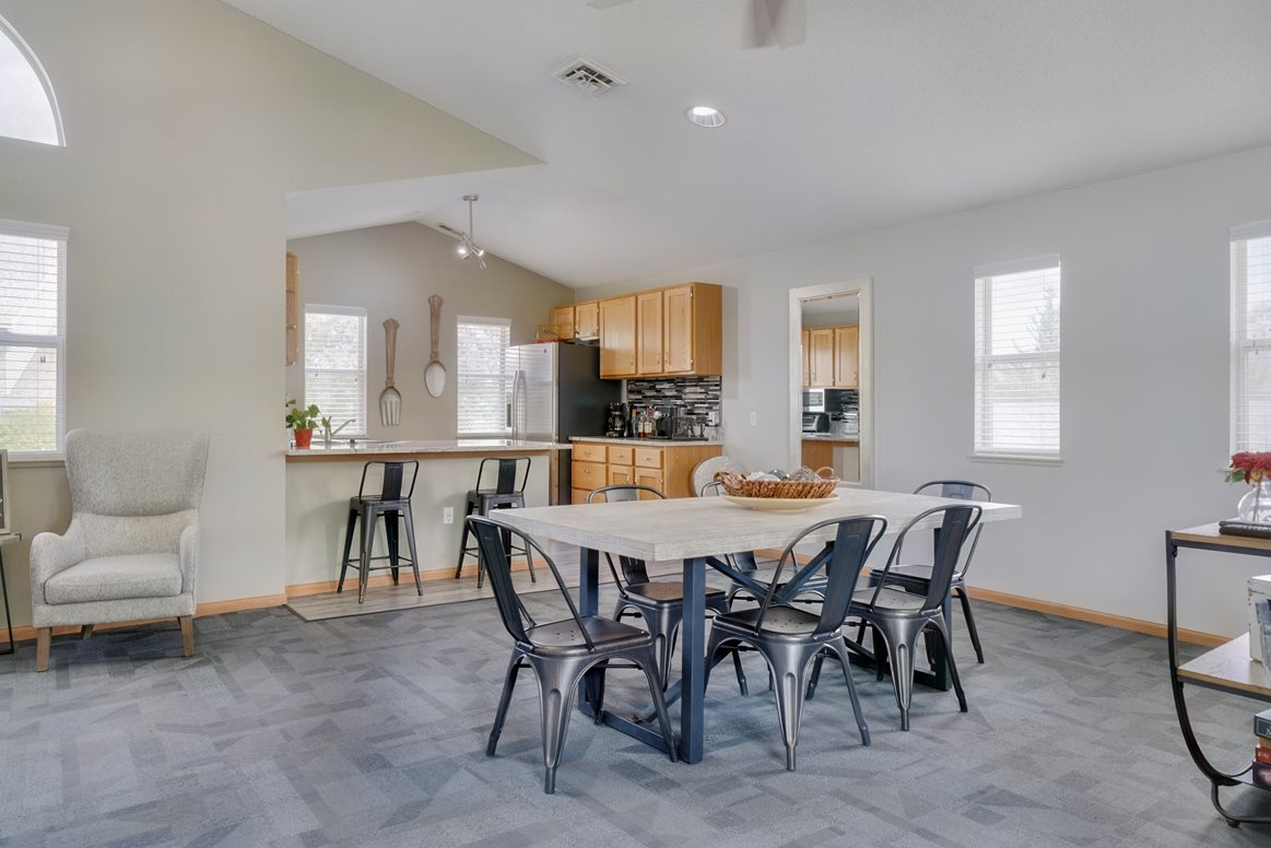 Dining space and community kitchen in the clubhouse at Skyline View apartments