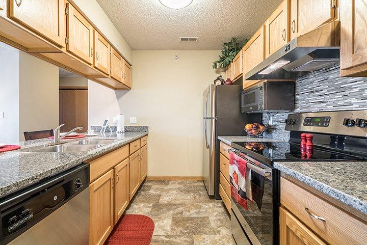 Galley style kitchen with up-to-date appliances at Skyline View Apartments in Lincoln NE