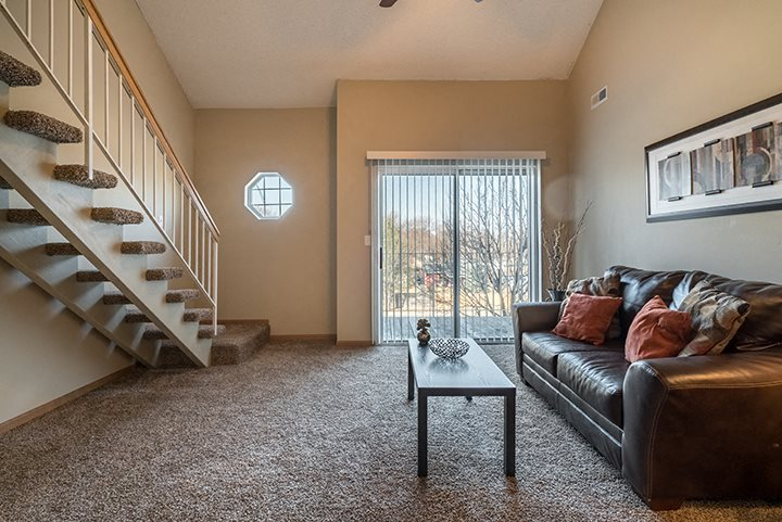 large living room with lots of natural light at Skyline View Apartments in Lincoln NE