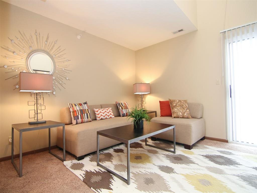 amazing living room with lots of natural lighting at Pine Lake Heights Apartments in Lincoln Nebraska