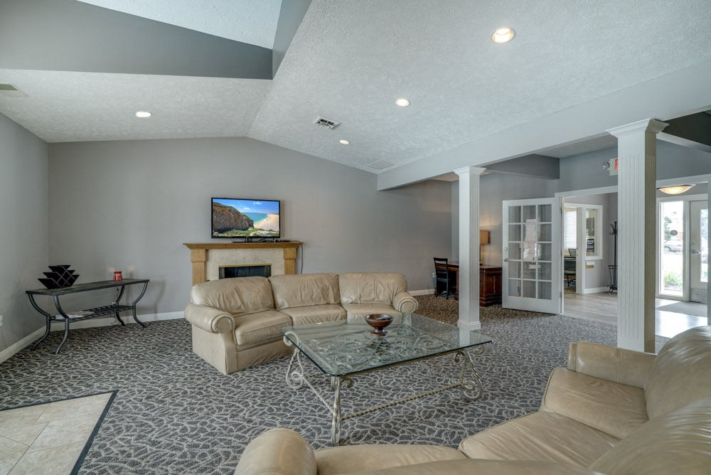Comfortable seating in the clubhouse at Pine Lake Heights Apartments