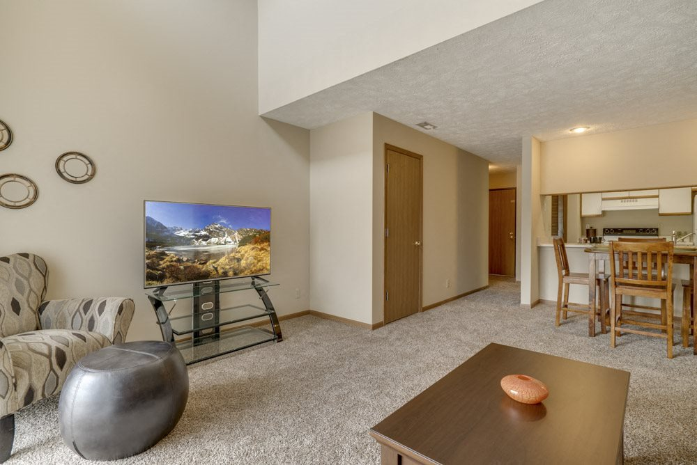 Living room area in Pine Lake Heights Apartments