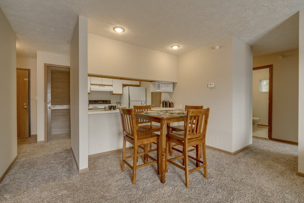 Dining area and kitchen view at Pine Lake Heights Apartments