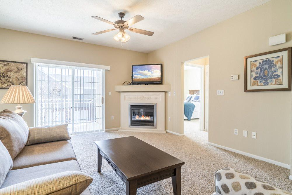 Interiors-Living room view of 1-bedroom townhome with balcony at Ridge Pointe Villas