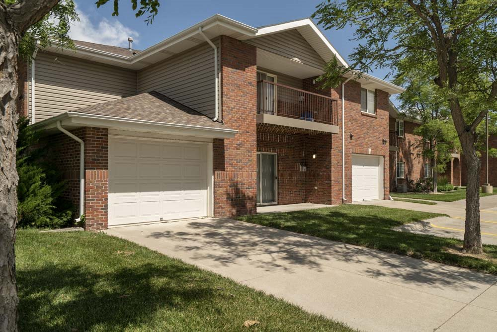Exterior view of apartments with attached garages at Pinebrook Apartments