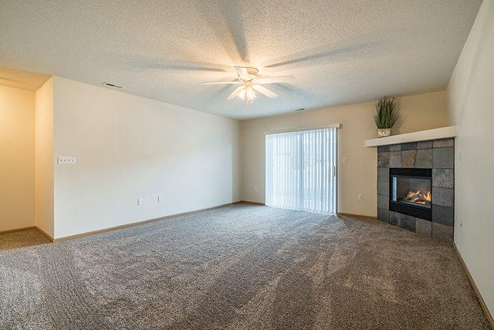 Fireplace in the living room for extra warmth at Pinebrook Apartments in Lincoln NE