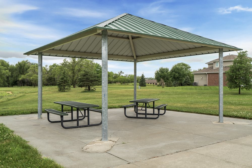 Pavilion and picnic tables at Cascade Pines Duplex and Townhomes