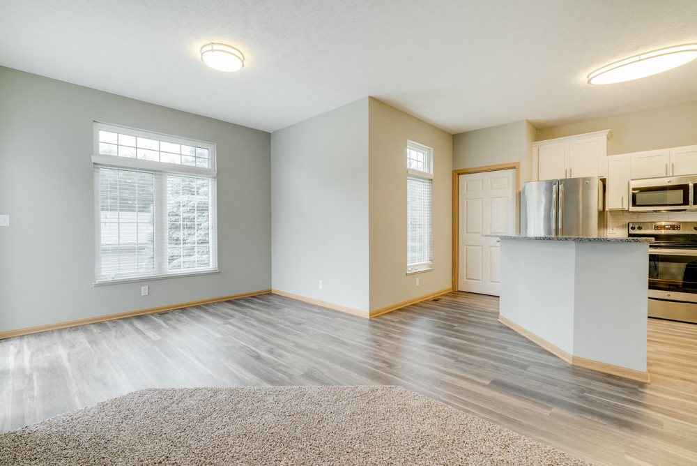 Open floor plan with kitchen and living room at Cascade Pines Duplex and townhomes