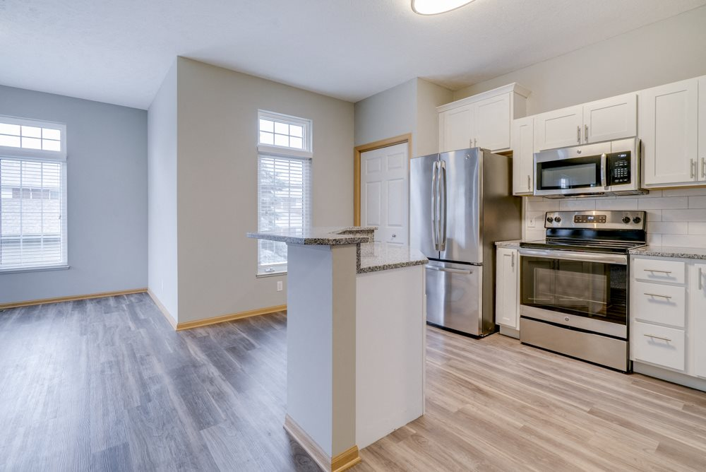 Kitchen with stainless steel appliances and island at Cascade Pines duplex and townhomes