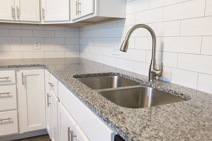 Stainless-steel sink in kitchen at Cascade Pines Town-homes Lincoln Nebraska
