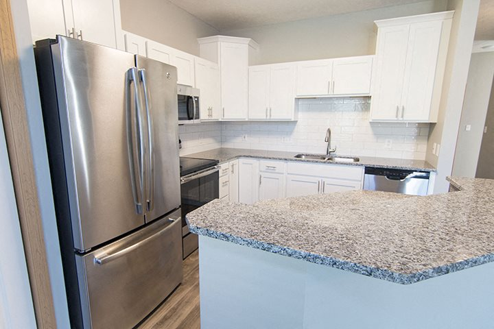 Stainless-steel appliances and hardwood-like flooring at Cascade Pines Town-homes Lincoln Nebraska