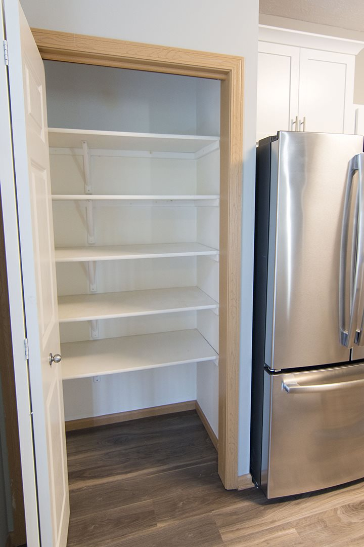 Large pantry in kitchen for extra storage at Cascade Pines Town-homes Lincoln Nebraska