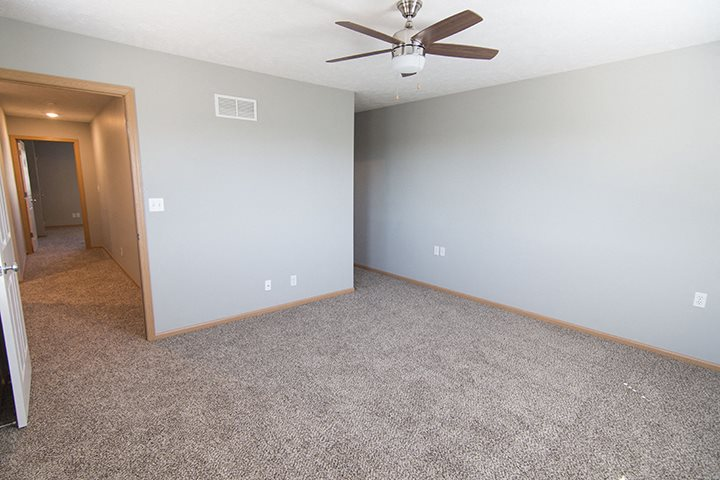 Large bedroom with lots of natural lighting at Cascade Pines Town-homes Lincoln Nebraska