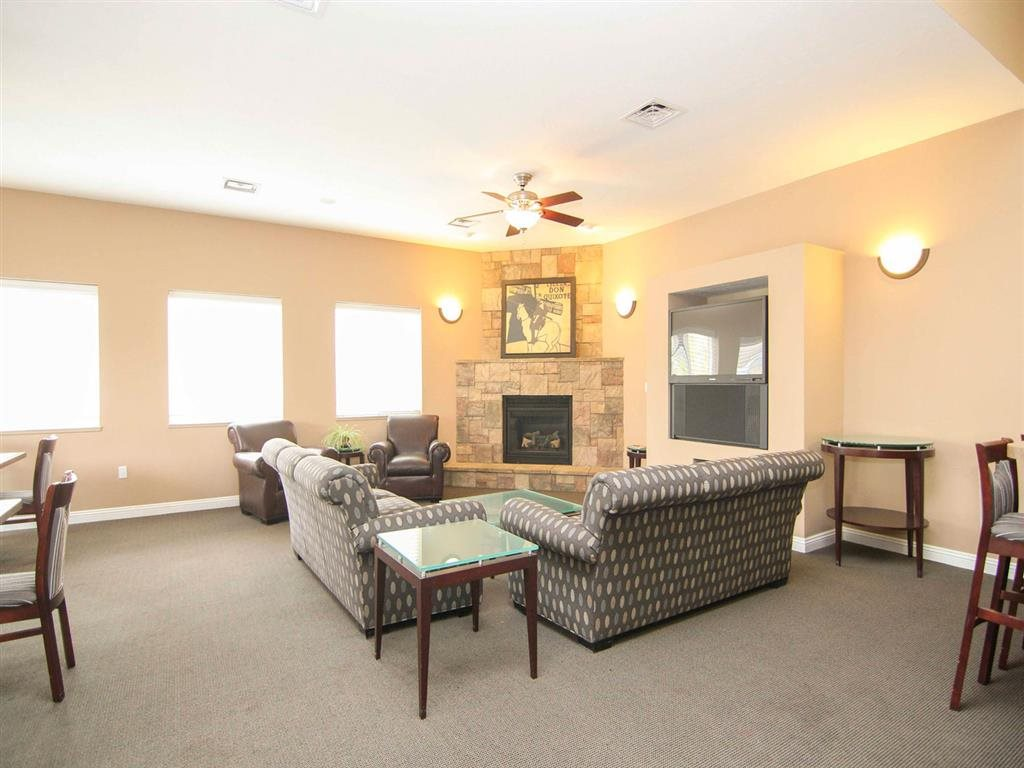Clubhouse complete with seating, a fireplace, and a large TV at Cascade Pines Duplex Homes in Lincoln NE