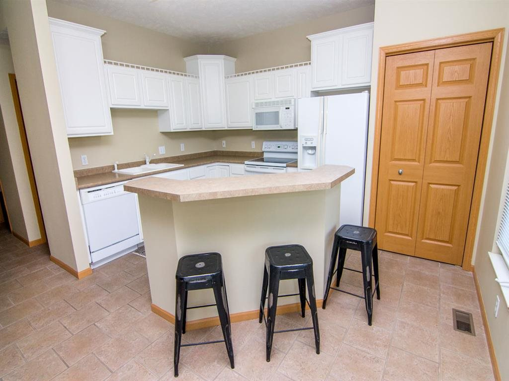 Kitchen with Island Bar in Cascade Pines Duplex Homes in Lincoln NE