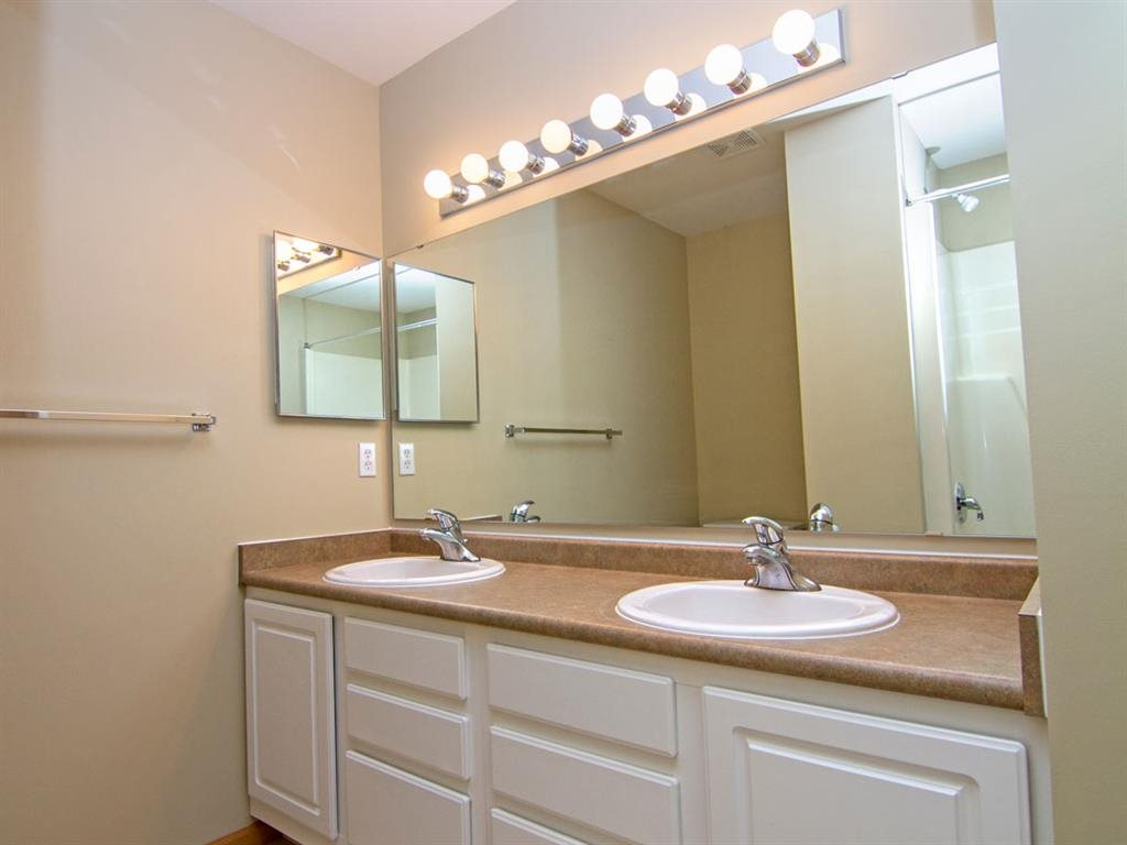 Master Bathroom with dual sinks and white cabinetry at Cascade Pines Duplex Homes in Lincoln NE