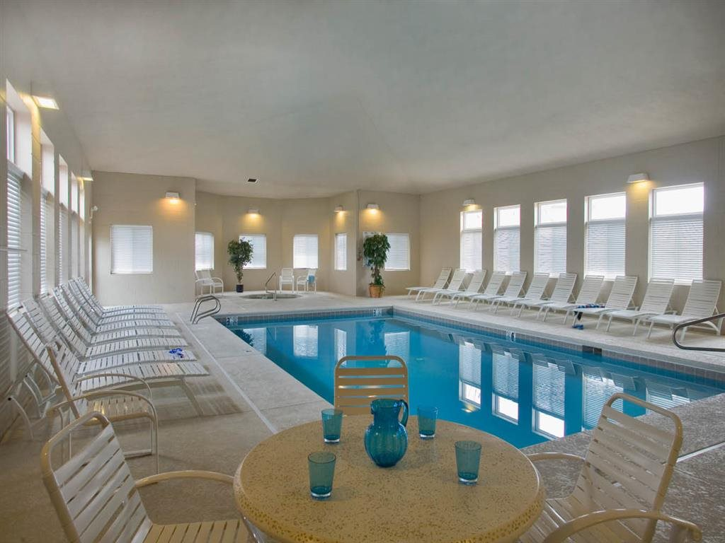 Indoor Saltwater Swimming Pool with lounge seating at Cascade Pines Duplex Homes in Lincoln NE