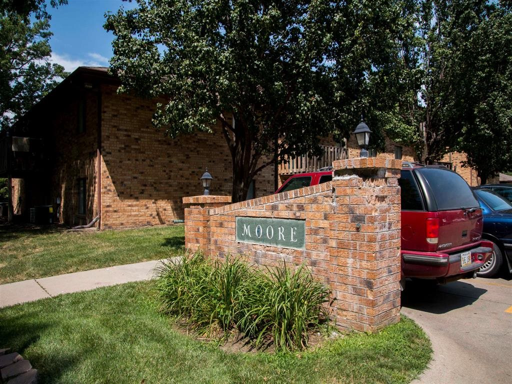 Sign entrance at Moore Place Apartments in Lincoln Nebraska