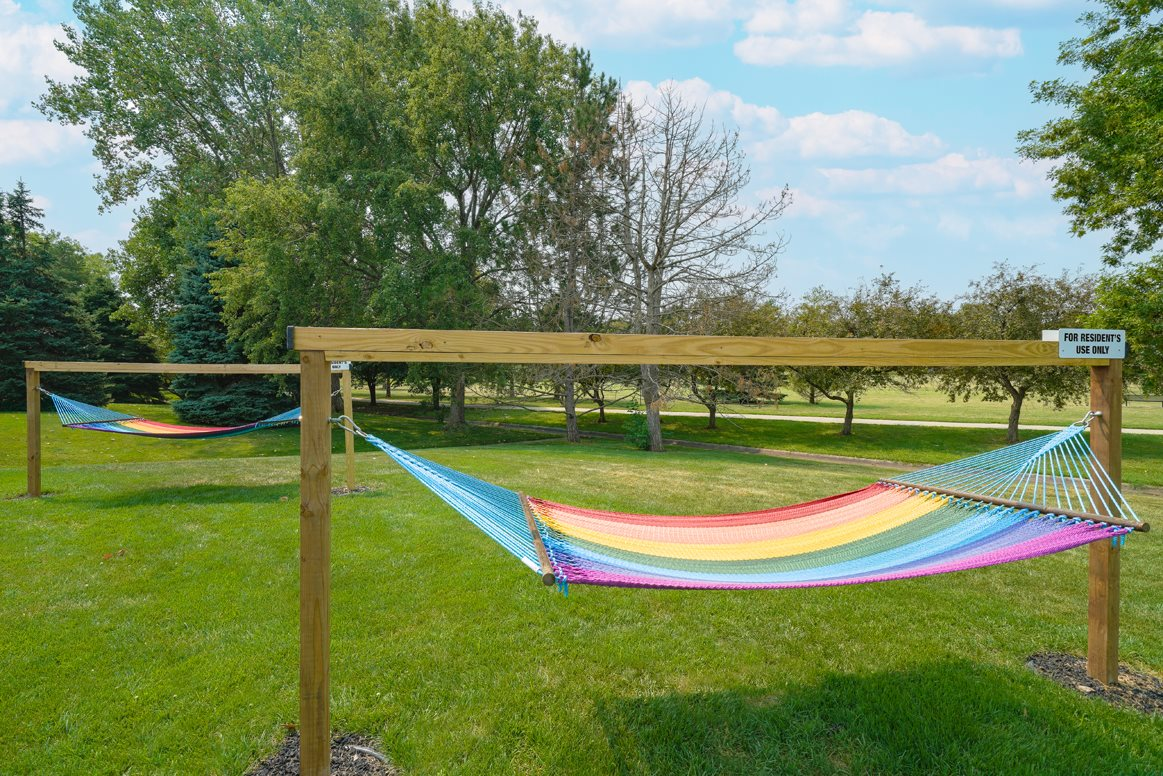 two rainbow striped hammocks outside the clubhouse at Williamsburg Park apartments in Lincoln