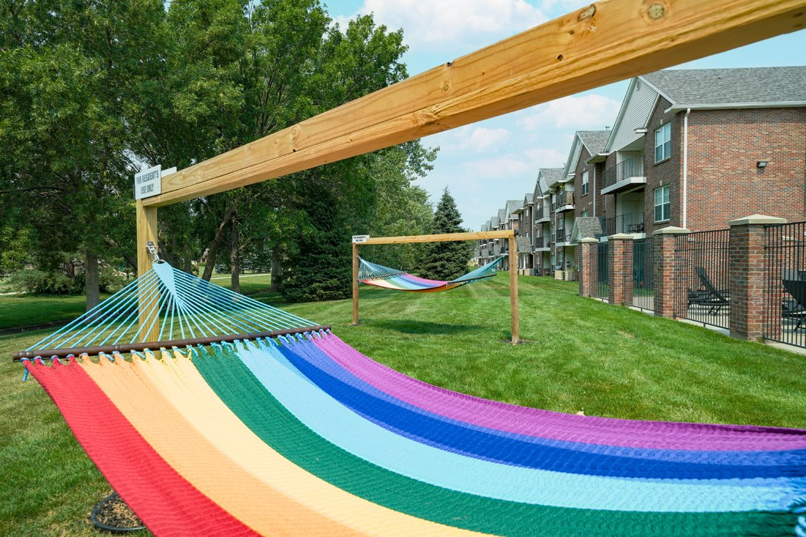 rainbow striped hammock outside the clubhouse at Williamsburg Park apartments in Lincoln