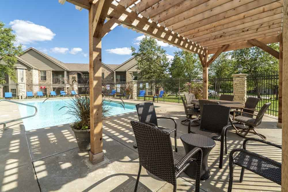 Pergola next to outdoor pool at Stone Creek Villas townhomes in west Omaha NE 68116