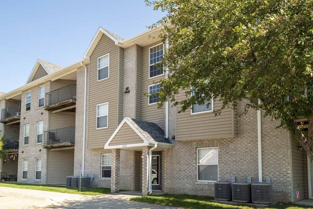 Buildings include controlled-access entries and balconies at Eagle Run Apartments in northwest Omaha 68164