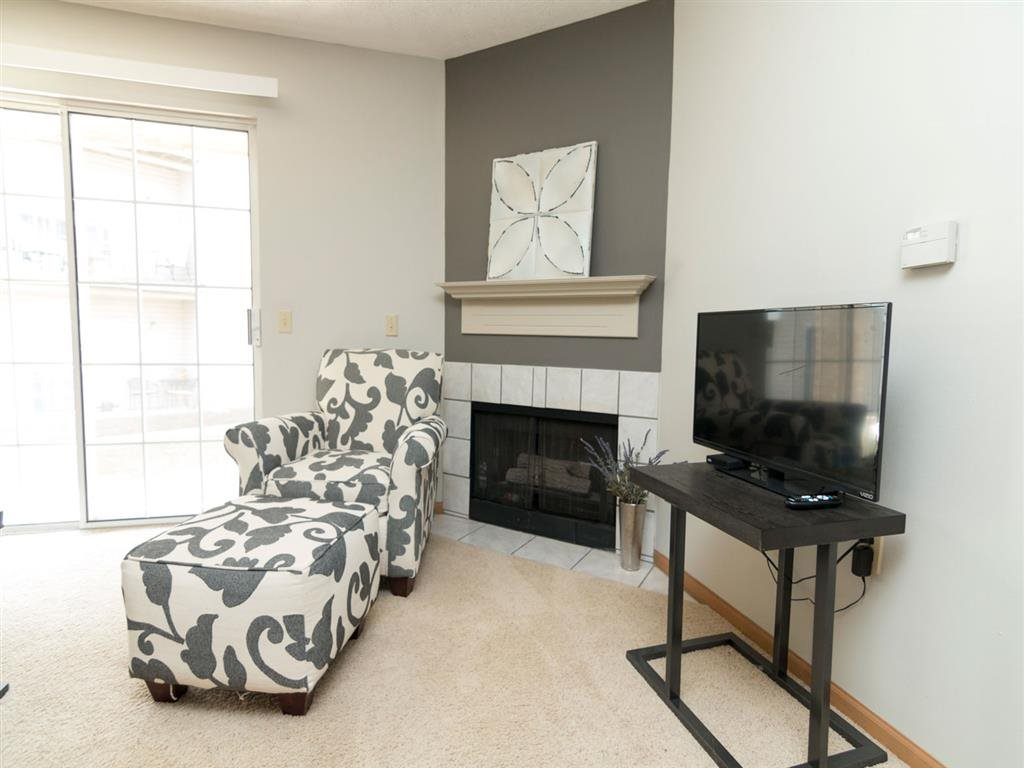 Fireplace in living room at Eagle Run Apartments in Omaha, NE