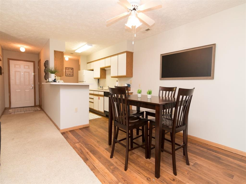 Renovated apartment with dining area at Eagle Run Apartments in Omaha, NE