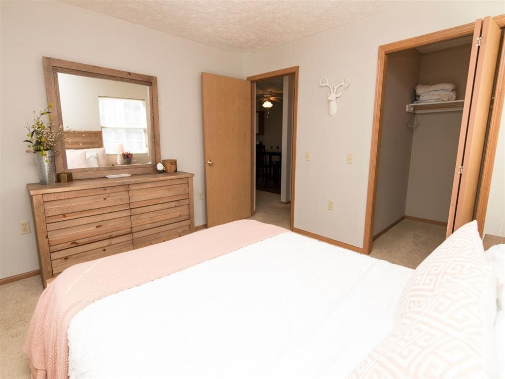 Bedroom view with large walk in closet at Eagle Run Apartments in Omaha, NE