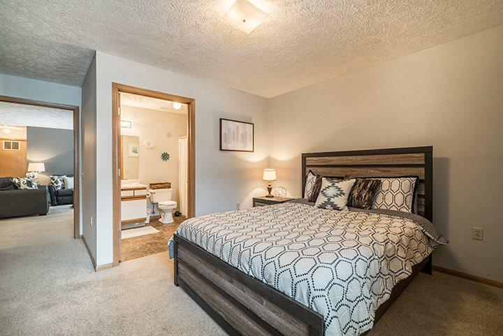 Large bedroom with view of attached bathroom at Eagle Run Apartments