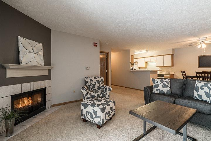 Large spacious living room with fireplace at Eagle Run Apartments