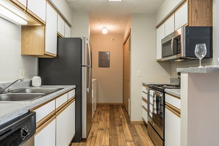 Kitchen with stainless steel appliances at Eagle Run Apartments