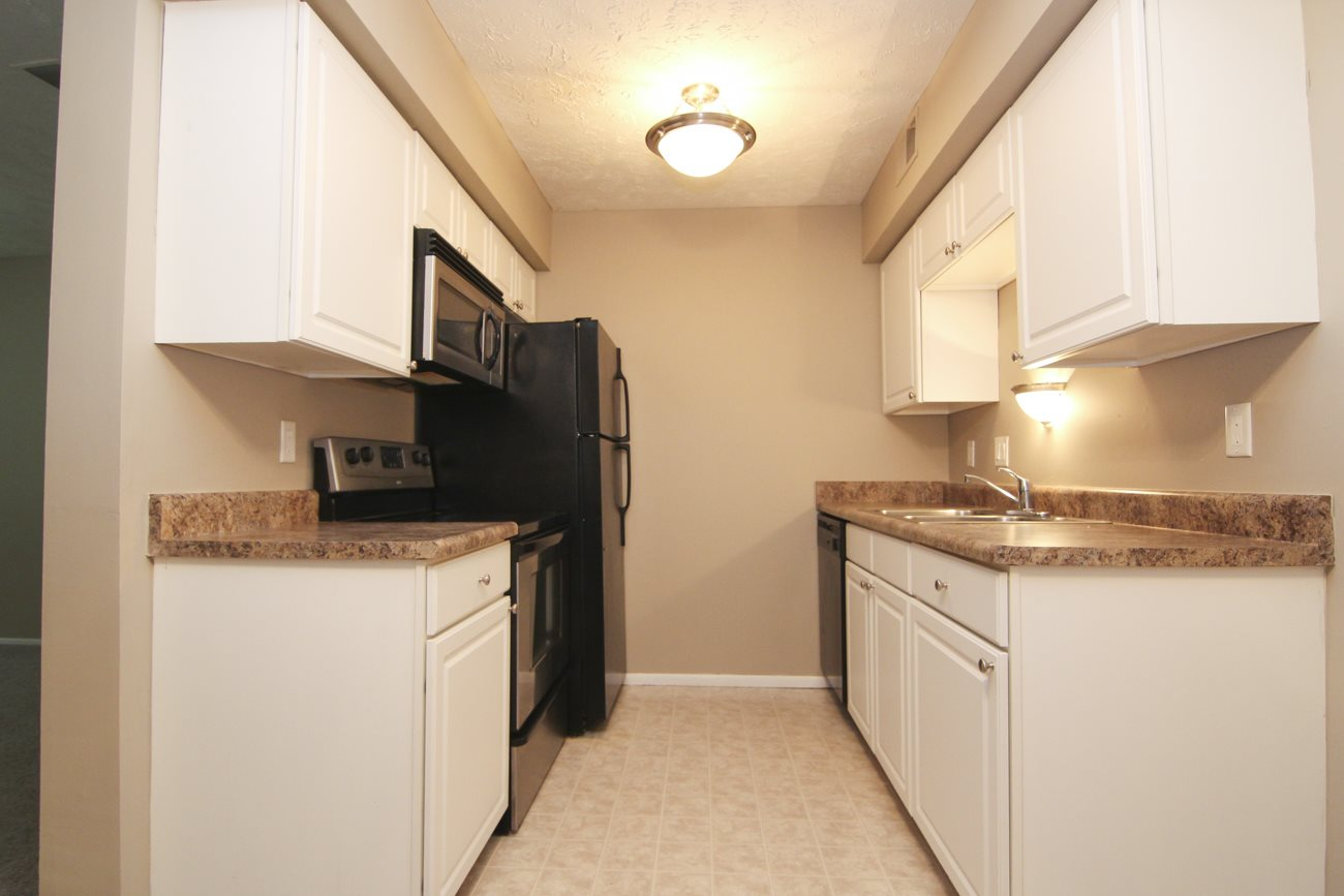 Interiors-Place 72 Apartments remodeled kitchen with white cabinetry