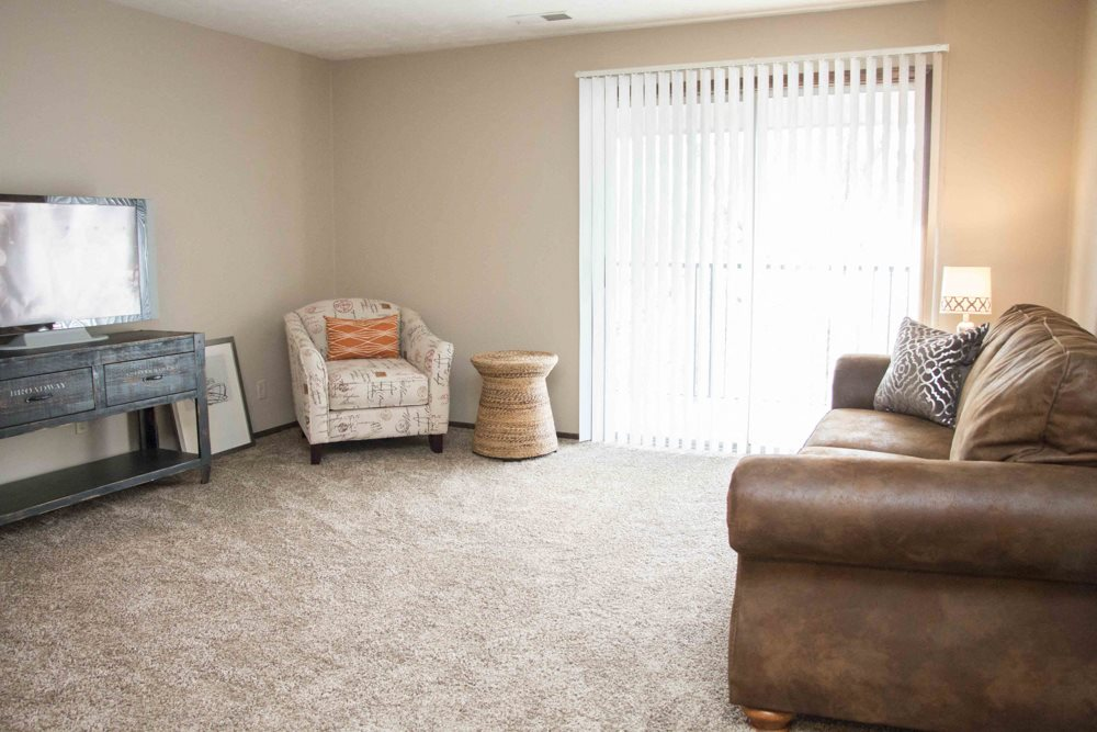 Living room with large sliding doors providing lots of natural light at Place 72