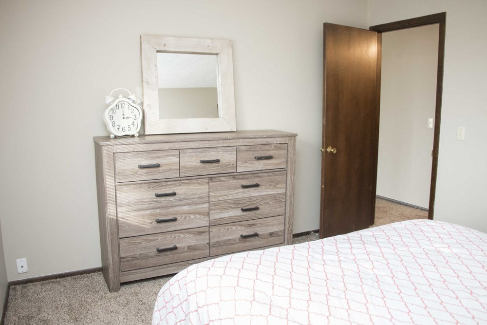 Bedroom with dresser at Place 72 Apartments near Aksarben