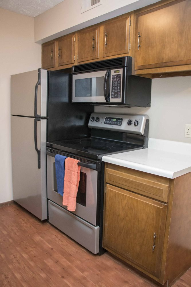 Updated kitchen and appliances with wood floors at Place 72 near Aksarben
