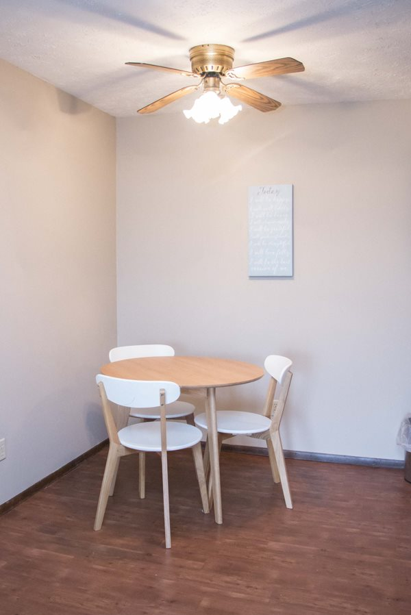 Dining area with wood floors at Place 72 near Aksarben