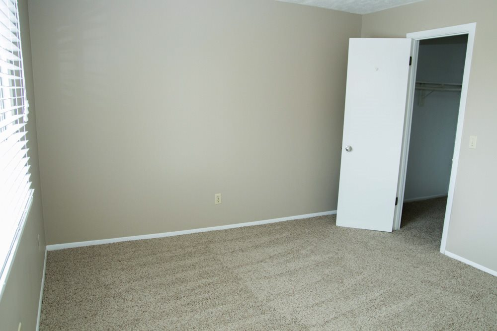 Open bedroom with large window for natural lighting at Place 72