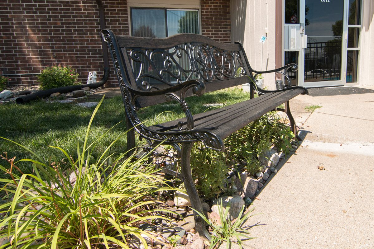 Exteriors-Sitting bench at Place 72 Apartments in Omaha NE
