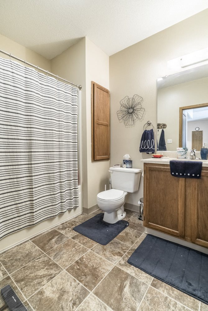Interiors-View of bathroom with bathtub in one-bedroom apartment