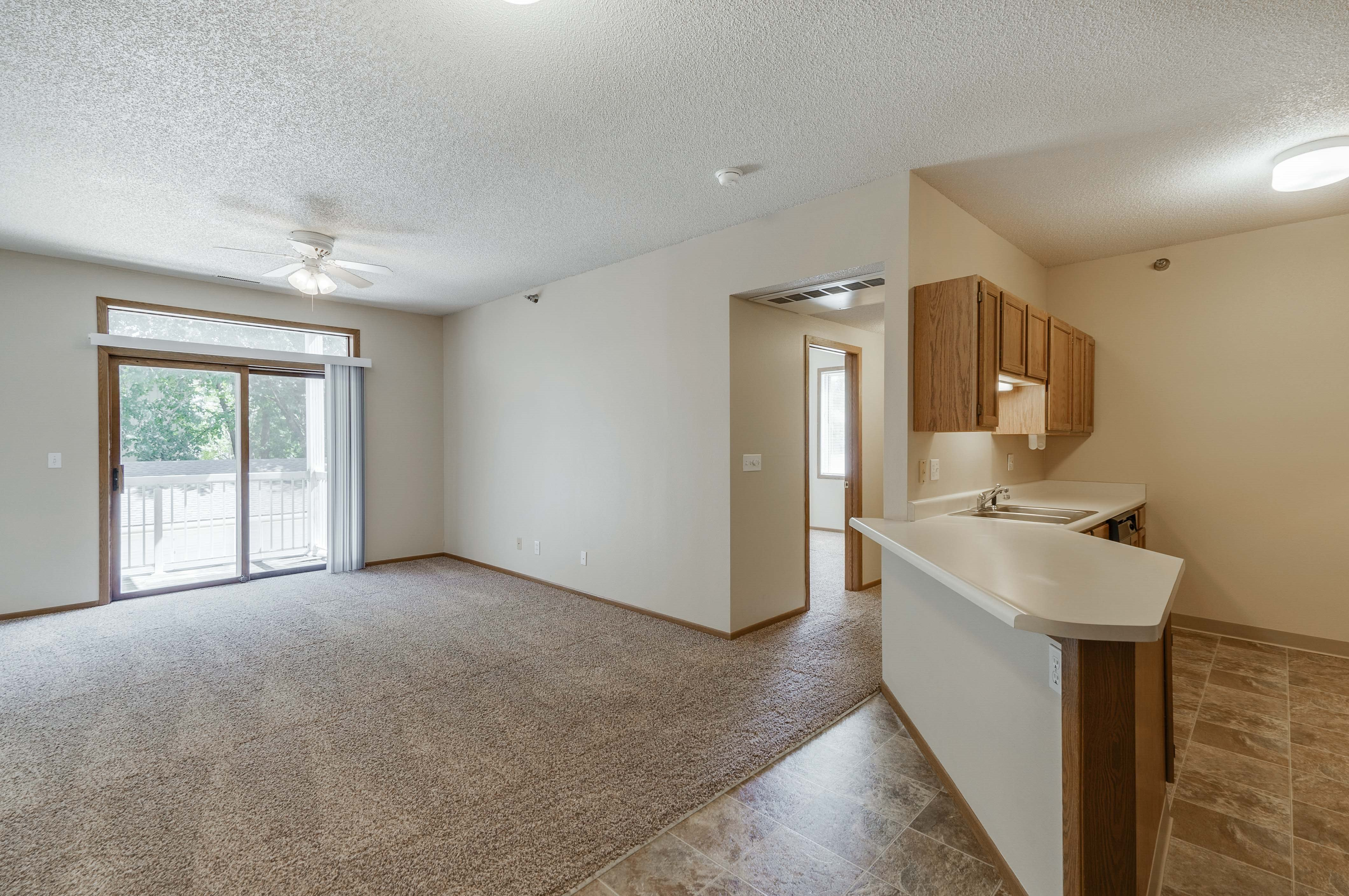 Open kitchen and living area with sliding glass door at Wyndham Heights
