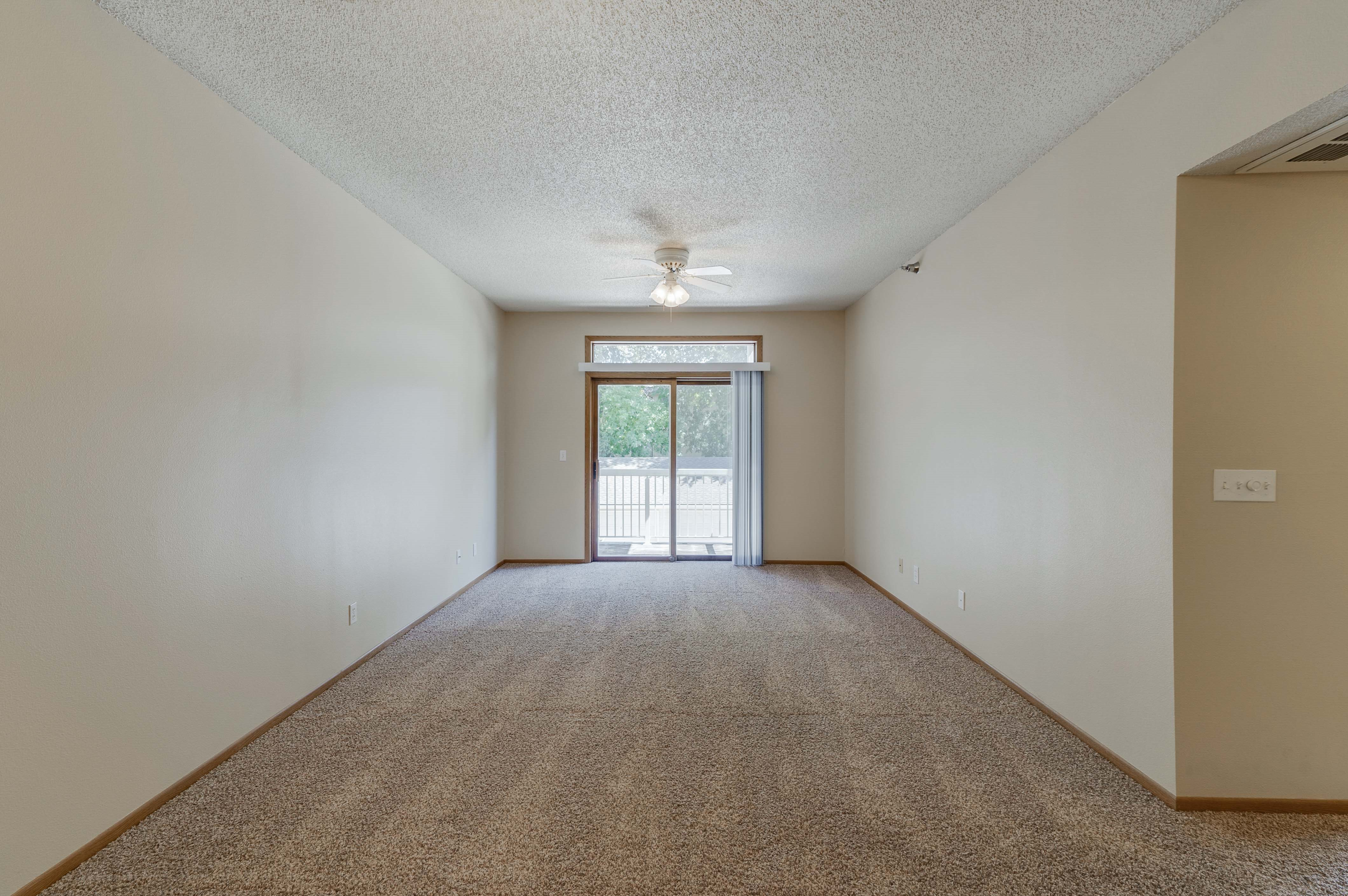 Large open living room looking out to the sliding glass door