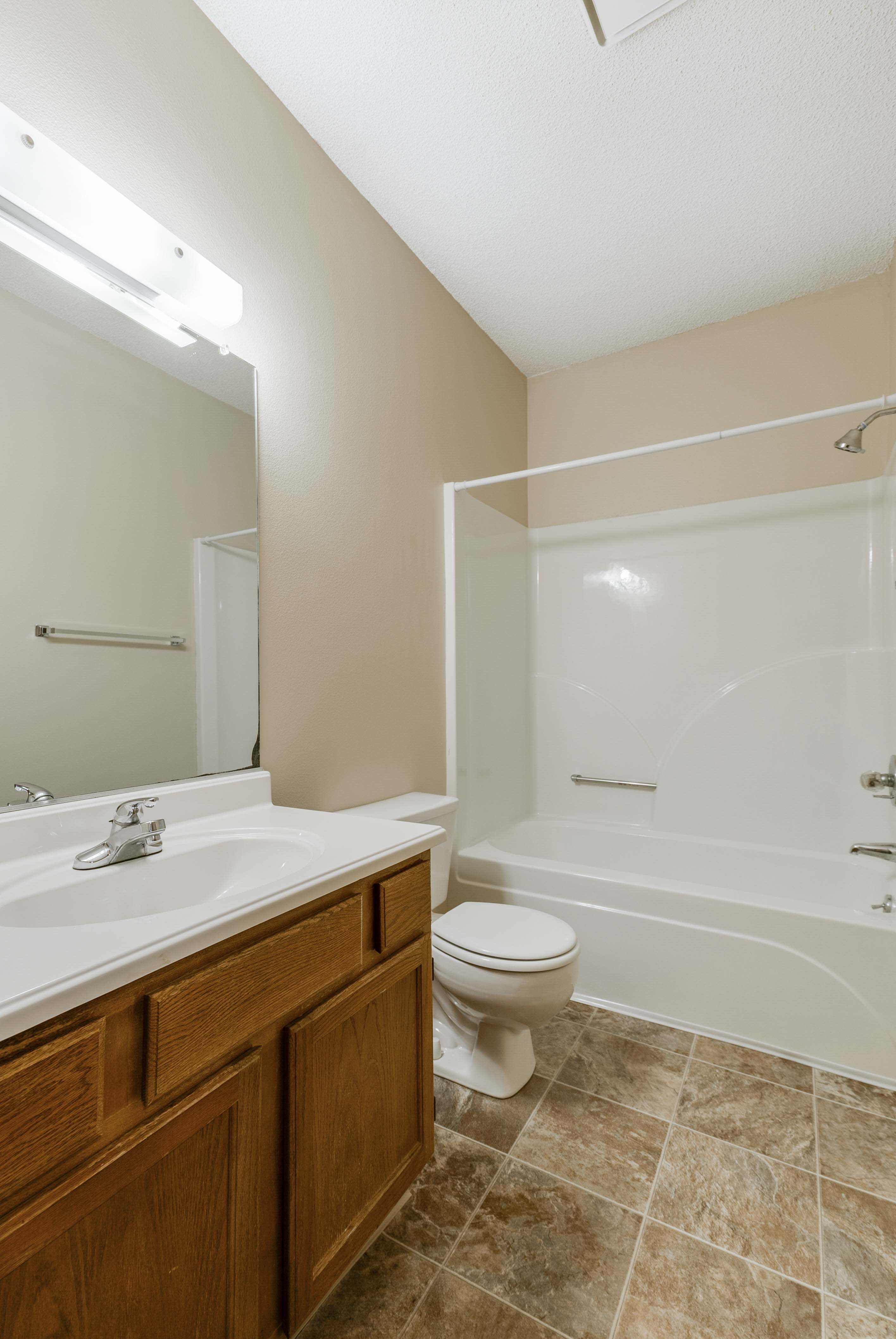Bathroom with vanity for storage and tub/shower combo at Wyndham Heights