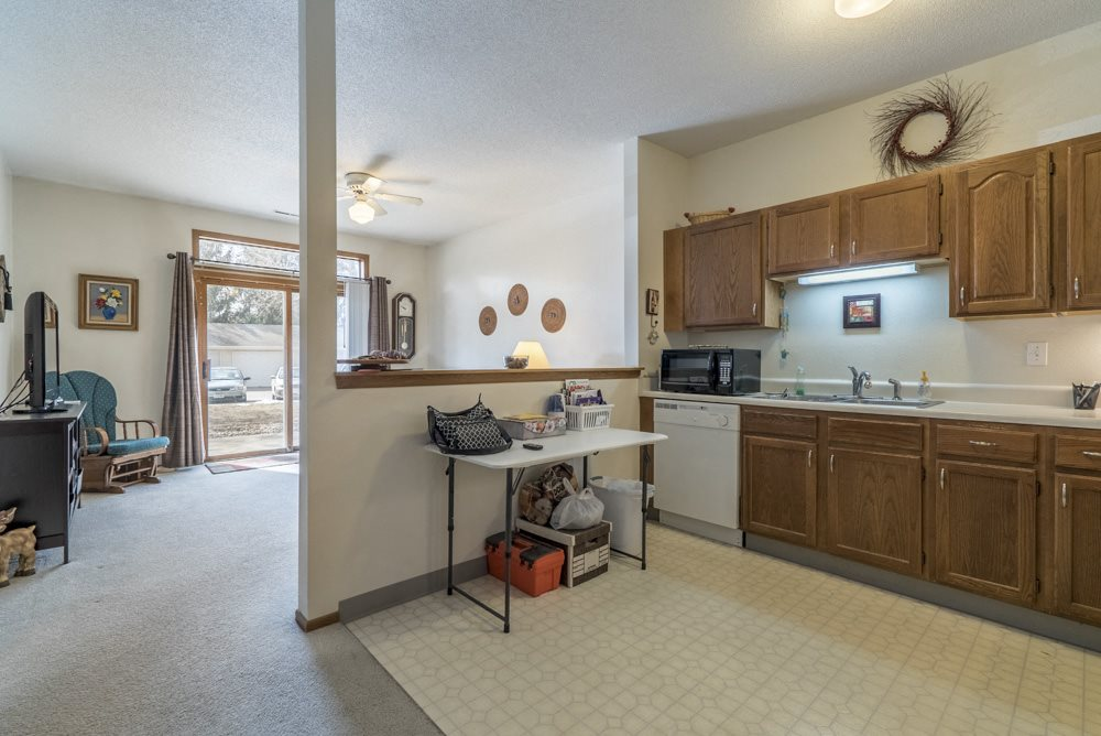 Interiors-View of kitchen overlooking living room in 2-bedroom floor plan