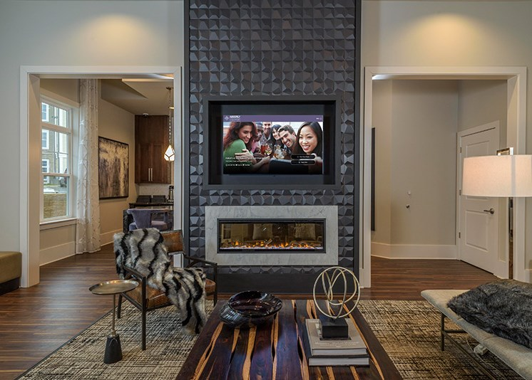 Club Room With Standard Fireplace at Abberly at Southpoint Apartment Homes by HHHunt, Virginia, 22407