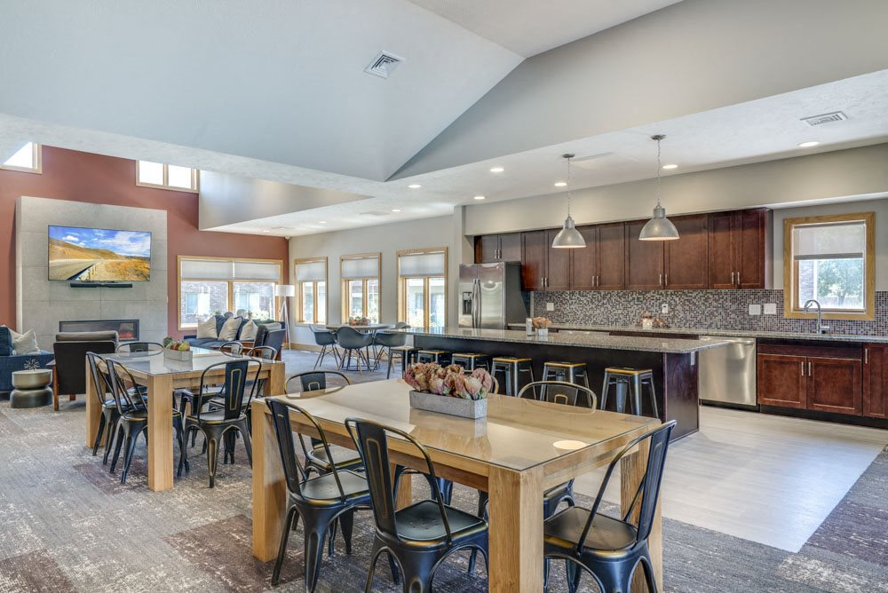 Clubhouse with seating and kitchen for resident's use at Fountain Glen Apartments